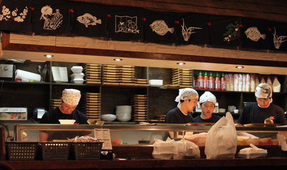 The chefs work fast at Sushi Town