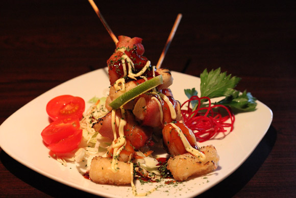 Bacon Wrapped Scallops on Skewers at Okaman Sushi